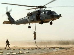 Operators fast roping from the 160th SOAR (A) helicopter