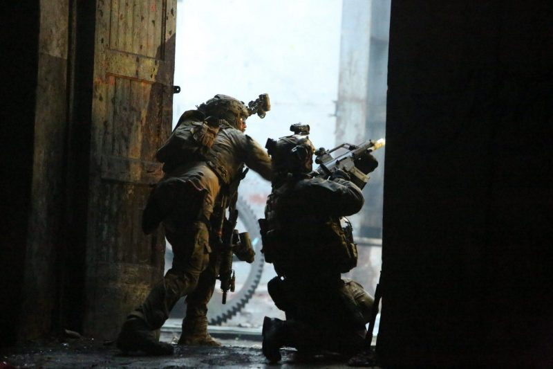 Operators from Estonian K-Commando providing suppressive fire during the exercise