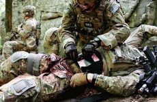 Special Operations Combat Medic applying tourniquet on wounded warrior