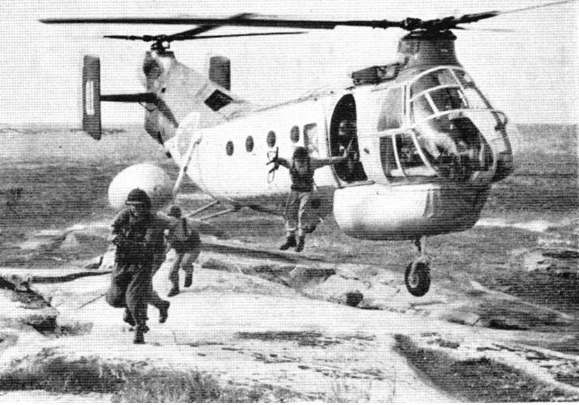 Sweden's Coastal rangers jumps off a Piasecki H-21 helicopter in late 1950s