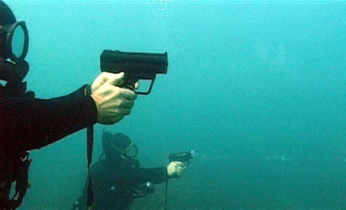 Military combat divers armed with Heckler and Koch P11 underwater pistol