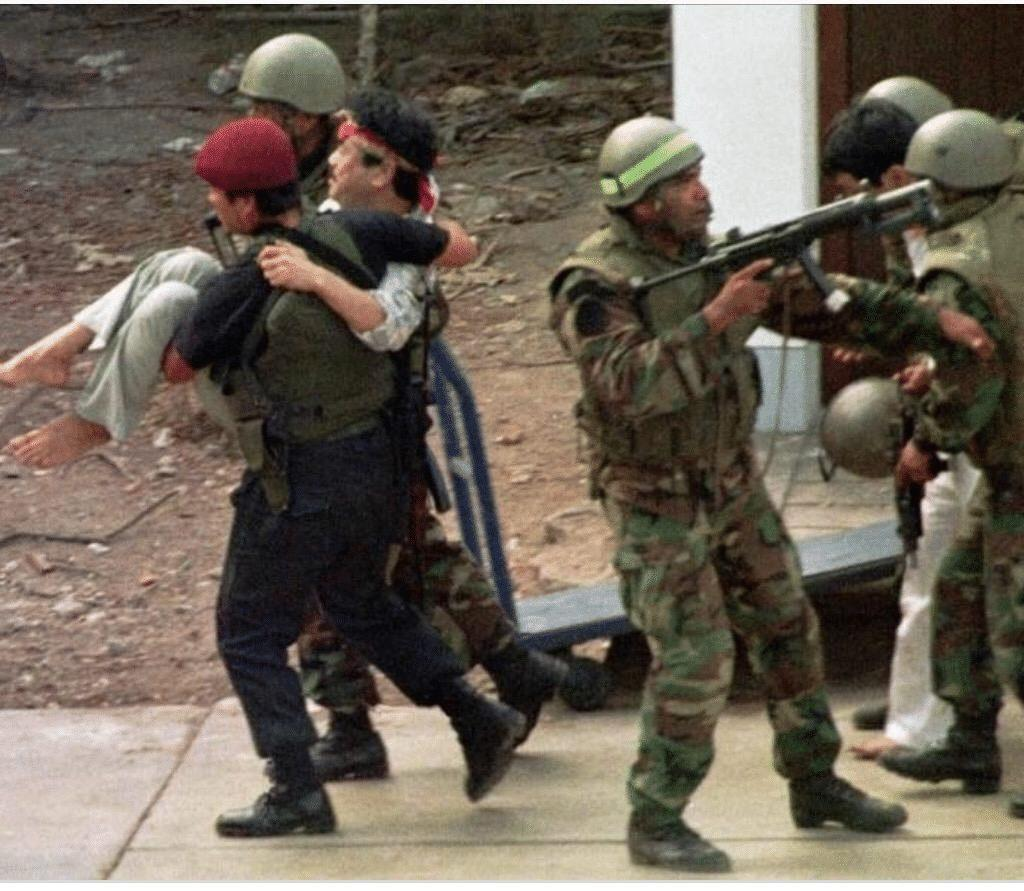 Peruvian commandos rescuing a Japanese diplomat during the Operation Chavin de Huantar