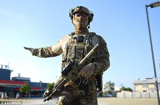 TAG West Operator brandishing his gun during the exercise