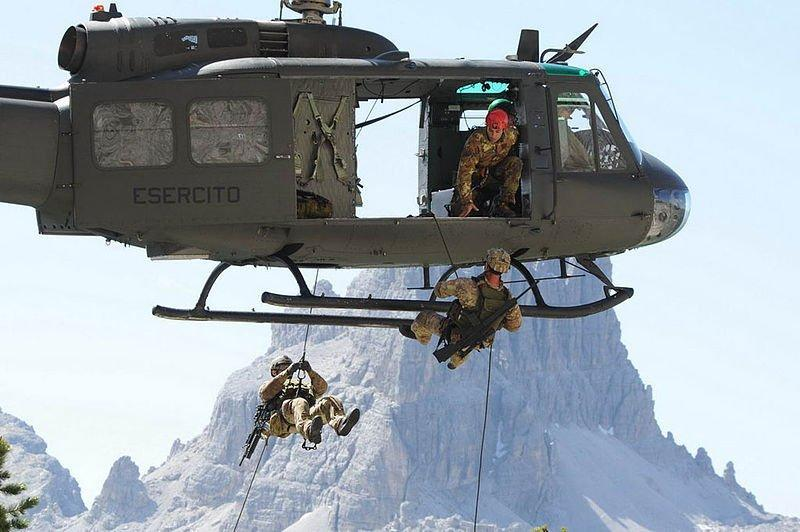 4th Alpini Parachutist Regiment members rappeling from the helicopter