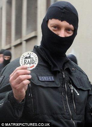 RAID operator brandishing unit's insignia