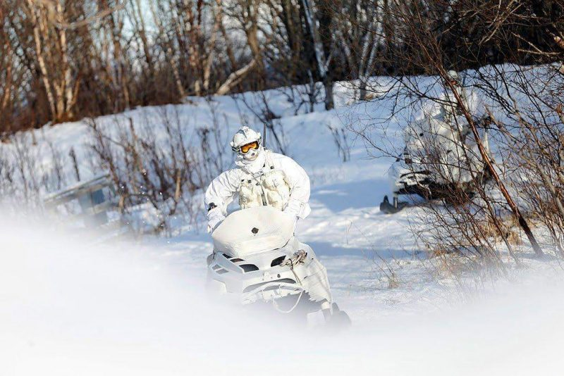 Member of the Finmark 7th Jager Company on snowmobile