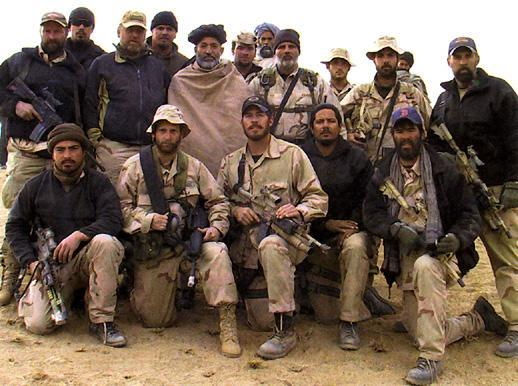 Hamid Karzai with Special Forces and CIA's then Special Activities Division (SAD) now Special Activities Center (SAC) in late 2001.