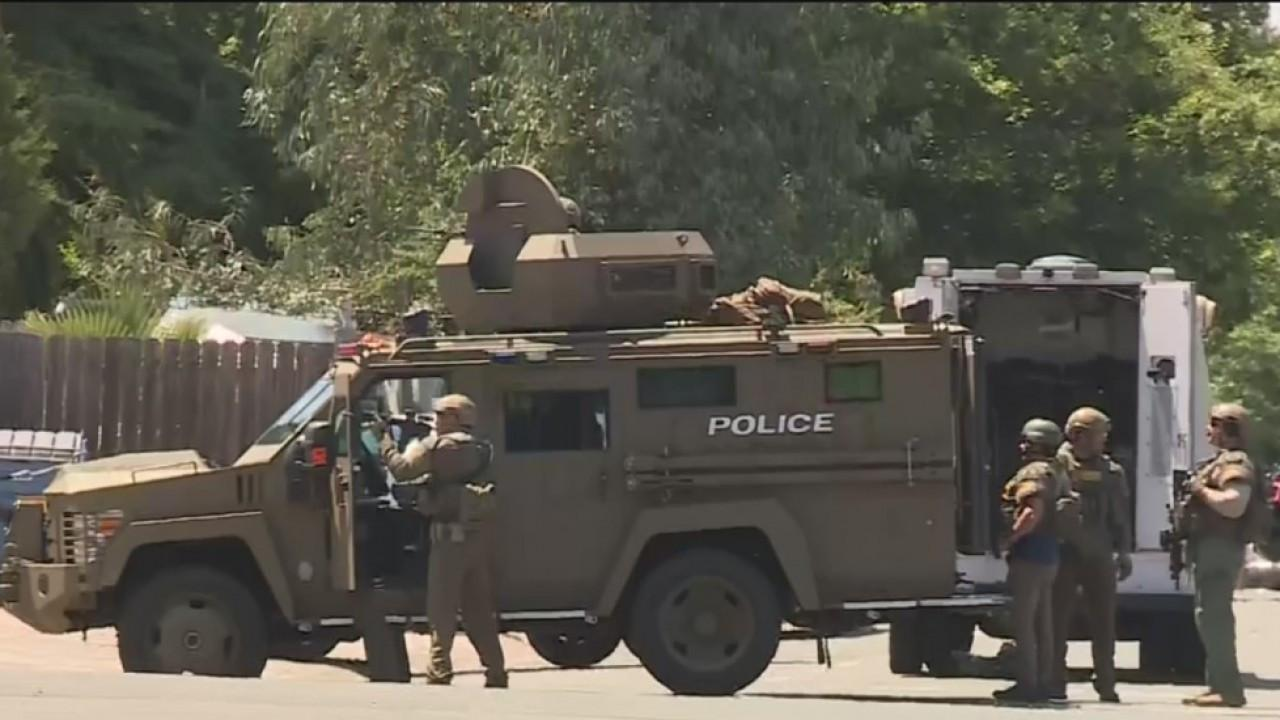 Sacramento Sheriff's Department Special Enforcement Detail (SED) operators looking for shooting suspect after standoff