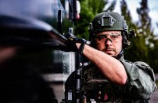 Washington County Tactical Negotiations Team (TNT) operator preparing to move to the target building