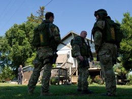 Sacramento Sheriff's Department Special Enforcement Detail (SED) operators executing the high-risk search warrant