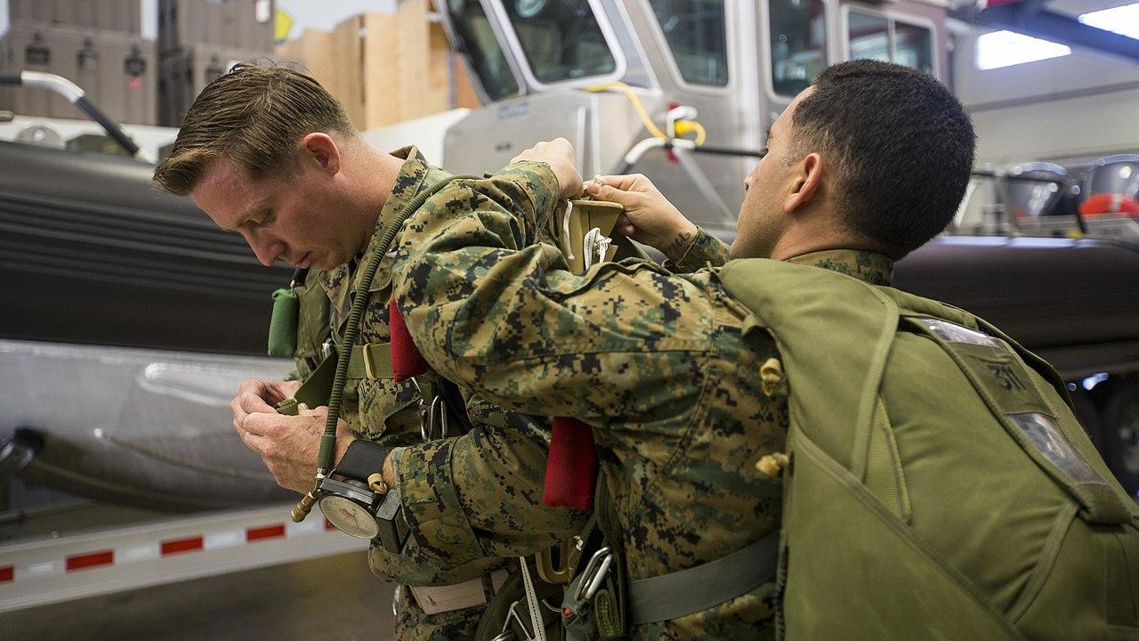 Marines from the 3rd Reconnaissance Battalion practice JumpMaster Personnel Inspection (JMPI) during the Military Free-Fall Jumpmaster Course, conducted by the U.S. Military Free-Fall School's Mobile Training Team at Kadena Air Base, part of the John F. Kennedy Special Warfare Center and School.