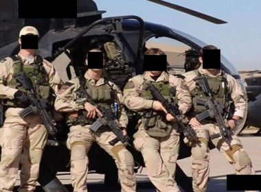 Special Operations Forces from JSOC at undisclosed location posing in front of helicopter