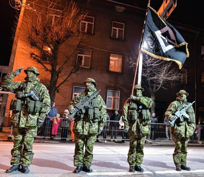 Estonia's most elite soldiers from Estonian Special Operations Forces ESTSOF standing in front of the unit's flag