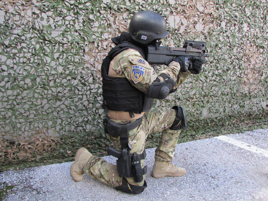 SIPA Special Support unit operator brandishing weapon