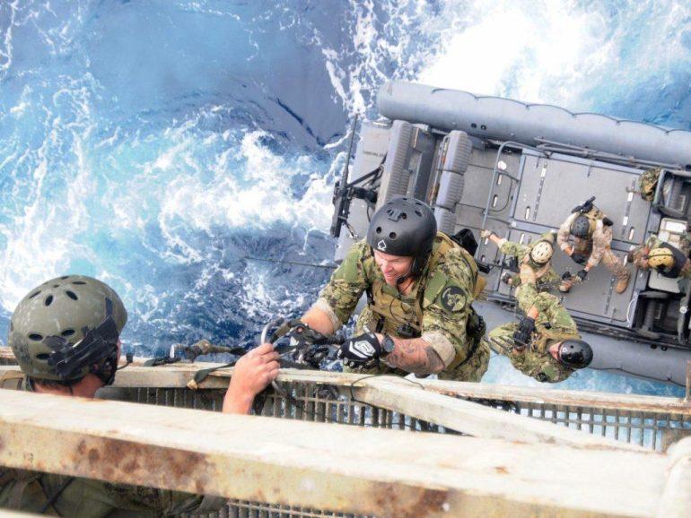 US Navy SEALs boarding ship