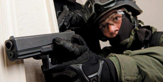 SWAT operators are often waring balaclavas or other face-covers in order to conceal their identities