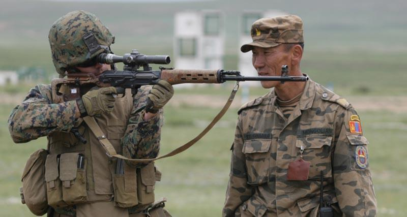 U.S Marines at shooting range aiming with SVD Dragunov combat sniper
