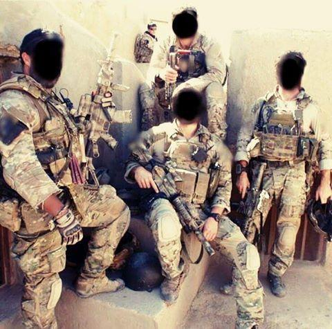 Special Air Service - SAS operators are posing with their weaponry