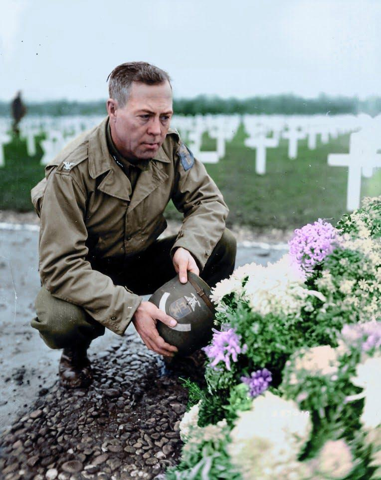 A grieving America soldier mourns his fallen brothers in France in 1944 - Stunning never-before-seen colourised World War II of US soldiers
