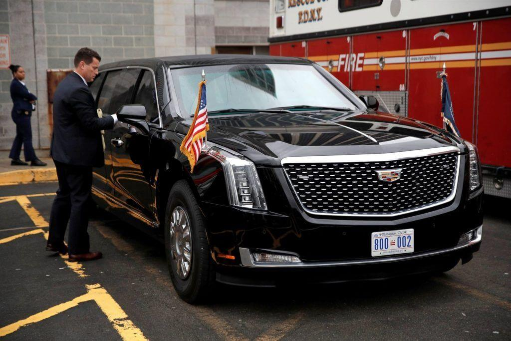 A U.S. Secret Service agent cleans the presidential limousine known as Cadillac One and the Beast