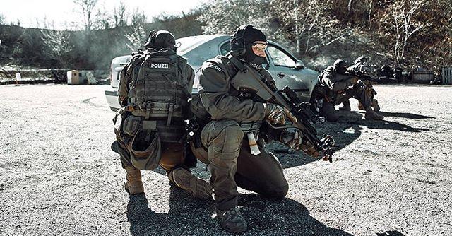 EKO Cobra operators armed with Steyr AUG assault rifle