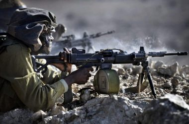 IDF infantry soldier firing from IWI Negev light machine gun