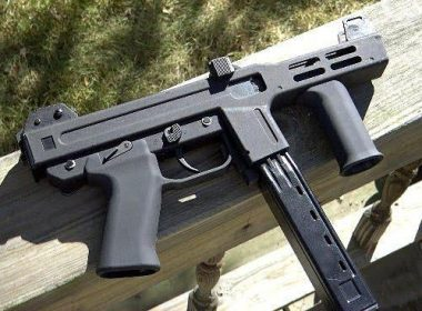 The Spectre M4 equipped with a suppressor