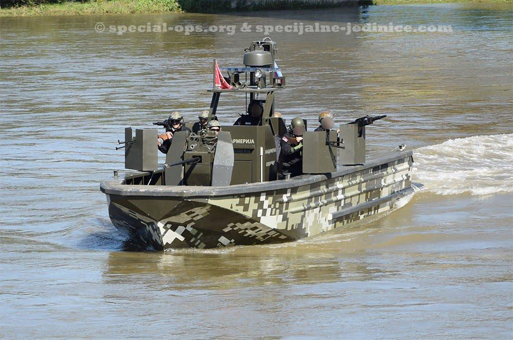 Operators of Serbian Gendarmerie on patrol boat during the exercise Drina 2016