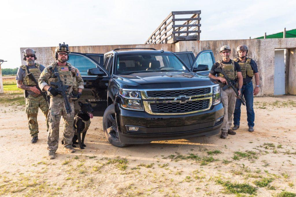four range complex instructors - Delta Force vets show us why they love Chevy's big SUVs