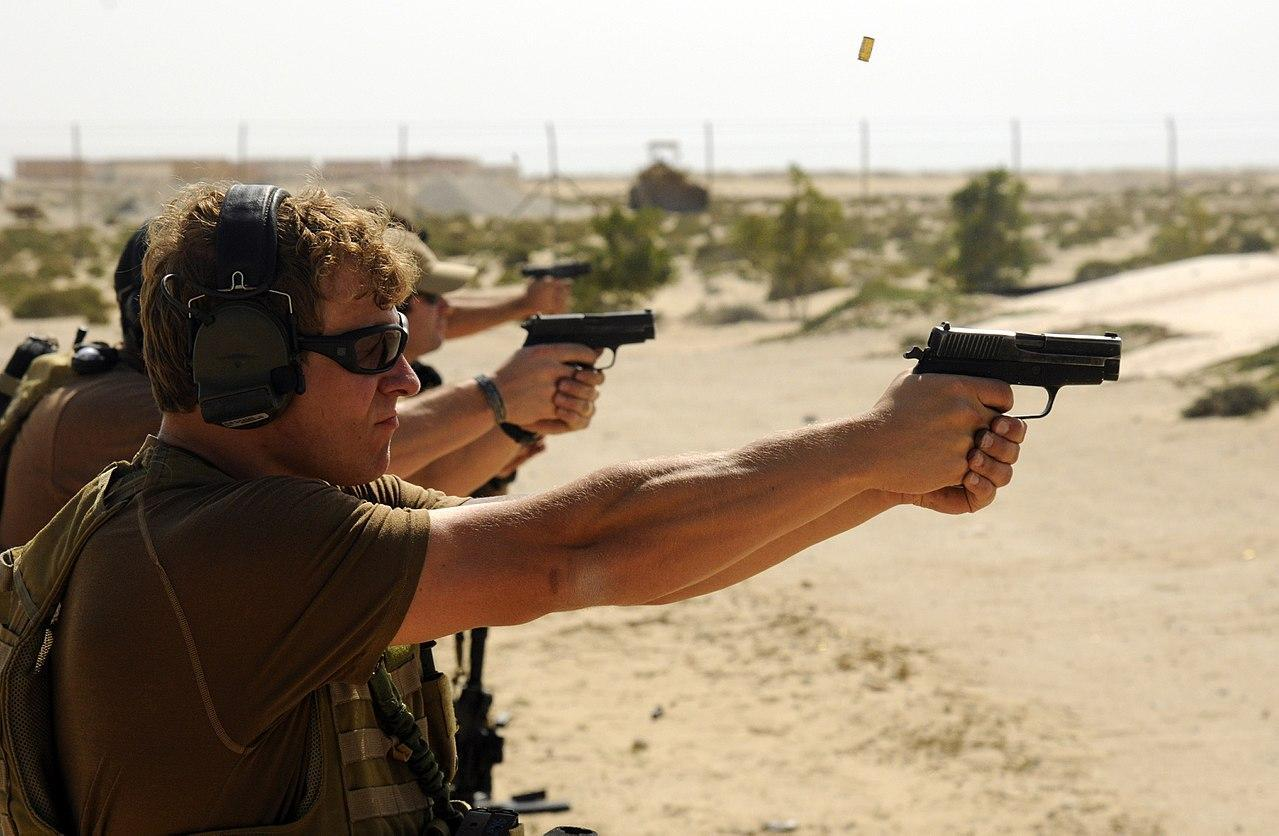 Navy SEALs at the shooting range firing from their Sig P226