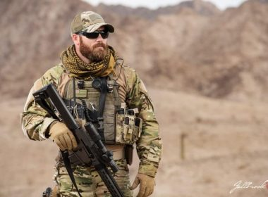 SOF Operator dressed in combat uniform with a beard
