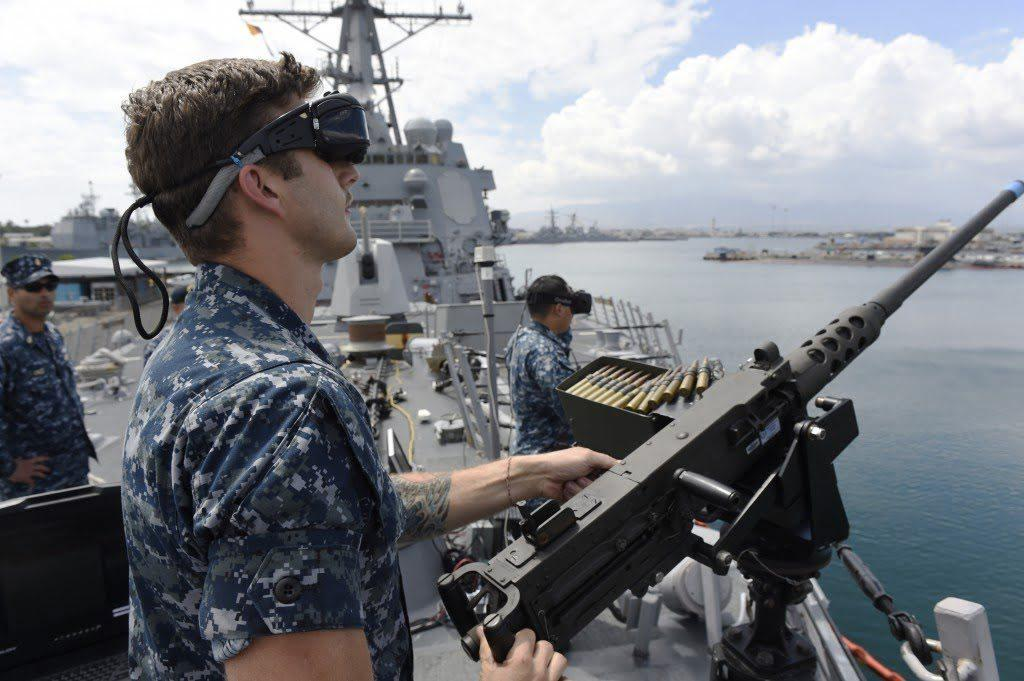 Sailor defending against virtual enemy combatants during a VR training program demonstration - U.S. Navy Recruits Using Virtual Reality (VR) Technology