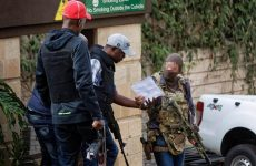 SAS operator is seen speaking with another armed rescuer during hostage crisis in Kenya