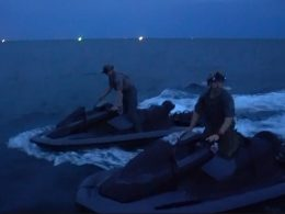 U.S. Navy SEALs on Jet Skis at undisclosed location night