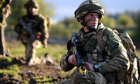 British Royal Marines operator posing with his weapon