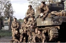 Members of the 101st Airborne sitting on the tank Band of Brothers TV Show 2001