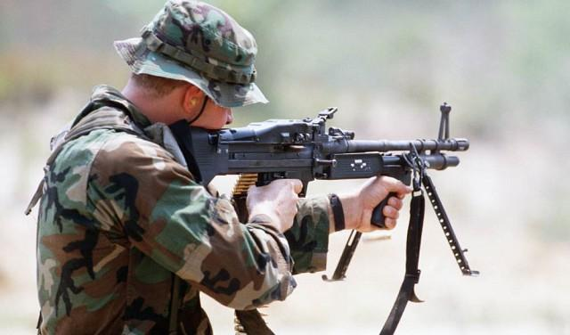A soldier aiming with M60E3 machine gun