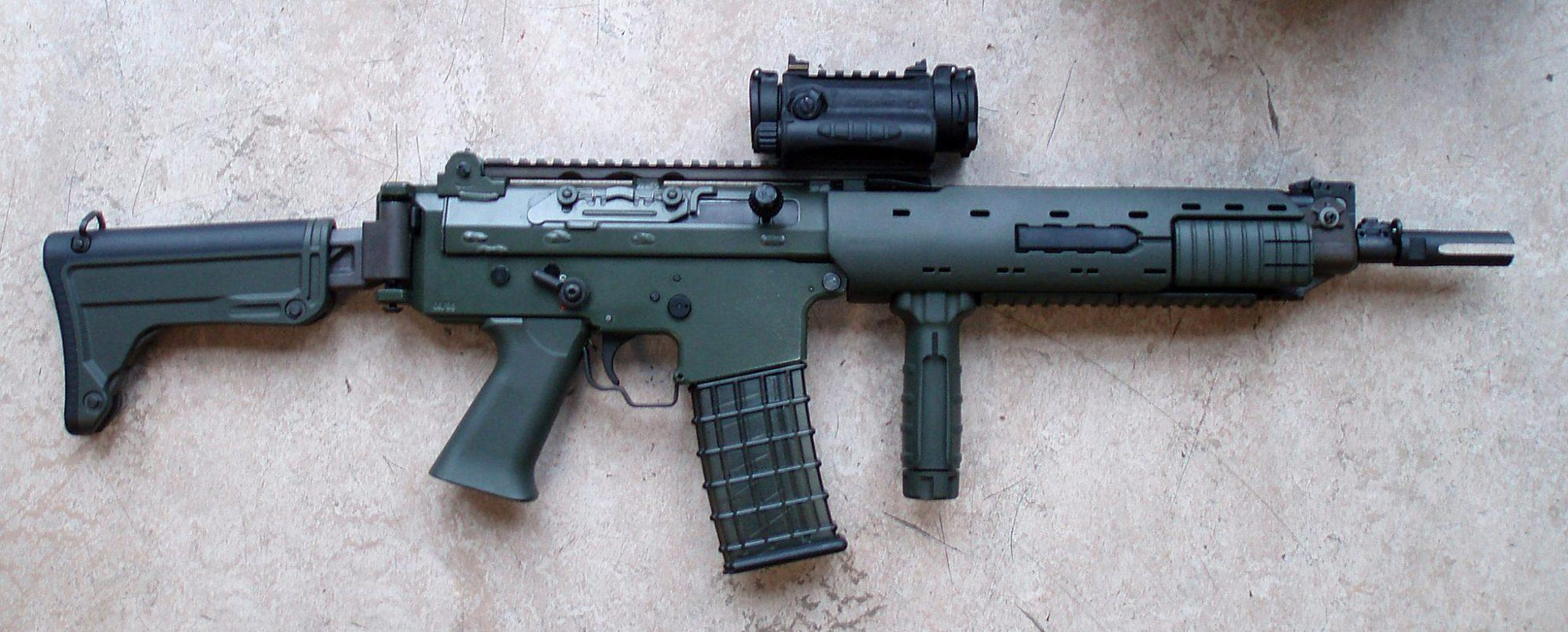 The final version of the Ak 5C with an Aimpoint red dot sight and forward vertical grip