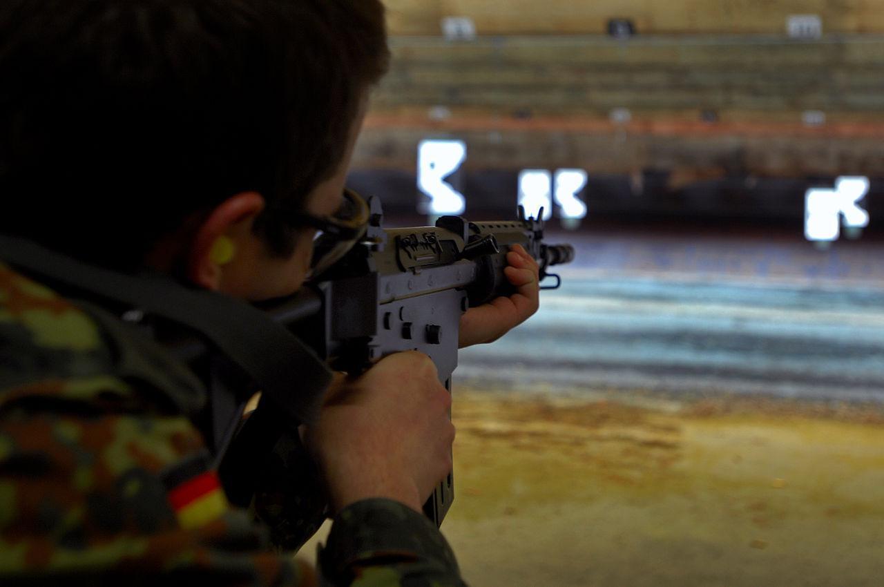 A German soldier aims an FN FNC assault rifle