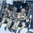 A group of Delta Force operators armed with HK416 assault rifles hanging out from the Blackhawk