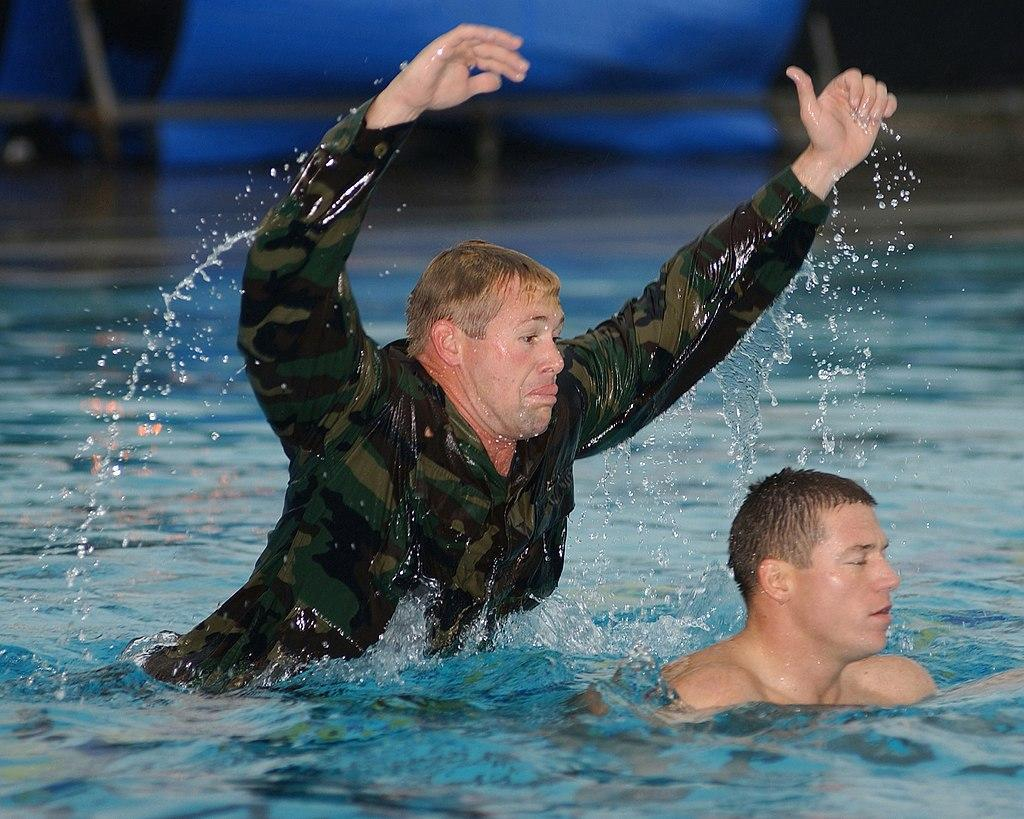 BUD/S Phase 2: An instructor attacks a candidate in the pool to simulate a combative drowning victim