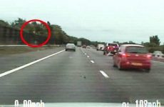 West Midlands Police say the dash-cam footage of the dramatic moment a drug dealer throws £200,000 of heroin from his car is the force's pursuit of the year. The 12-mile chase happened along the M6